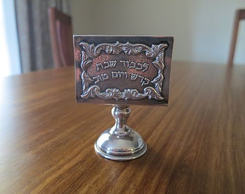 A silver matchbox holder for ritual use on Shabbat with inscription in Hebrew Shabatna kibritna kutija - Shabbat matchbox holder.jpg