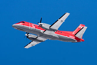 Northwest Airlink - Northwest Airlink Saab 340B/Plus operated by Mesaba shortly after takeoff from Minneapolis St-Paul
