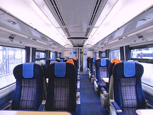 British Rail Class 159 - The interior of refurbished First Class, showing the new seats, ceiling mounted LED Passenger Information Displays and improved saloon lighting