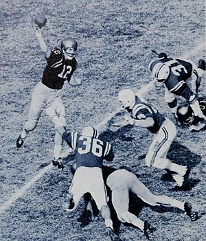 Forward pass - Quarterback Roger Staubach of Navy tosses a pass against Maryland just as the pocket collapses.