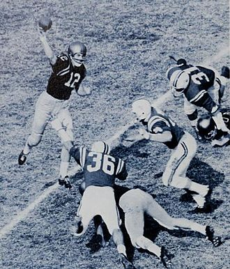 Forward pass - Quarterback Roger Staubach of the Navy Midshipmen throwing a pass against Maryland just as the pocket collapses, 1964