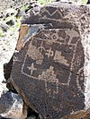 Petroglyphs on a large rock at Petroglyph National Monument