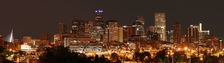 The skyline of downtown Denver with Speer Boulevard in the foreground, facing east.