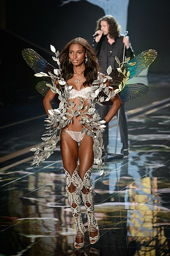 efcb887a3d4b2 Victoria s Secret Wings. Jasmine Tookes walks the ramp wearing lingerie and  butterfly wings