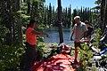 2016. Cindy Froyd, Iain Robertson, and Matt Watkins prepare to process a lake sediment core. Mt. Hood National Forest, Oregon. (38109534532).jpg