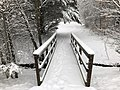 2018-03-21 09 06 11 View along a snow-covered walking path as it crosses a bridge in the Franklin Farm section of Oak Hill, Fairfax County, Virginia.jpg