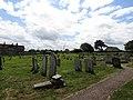 2018-06-13 Churchyard, Parish church of All Saints, Mundesley.JPG