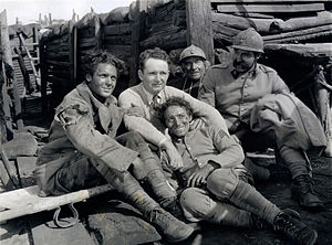 Émile Chautard - Director Frank Borzage, center, with cast members (from left) Charles Farrell, George E. Stone (reclining), Émile Chautard, and David Butler on the battlefield set of 7th Heaven (1927)