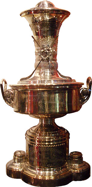 Amateur Hockey Association of Canada - The Senior Championship Trophy of the AHAC. Now on display at the Hockey Hall of Fame in Toronto. Two player figures on each side of the base are lost.