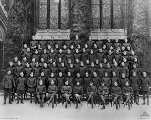 Cedric Howell - Group portrait of flight instructors and pilot cadets in Oxford, England. The cadet pilots were among the batch of 200 men recruited from the Australian Imperial Force for flight training in the Royal Flying Corps. Howell is far left, back row.