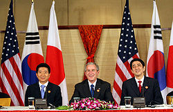 Shinzo Abe at APEC 2006, with U.S. President George W. Bush and President Roh Moo-hyun of South Korea.