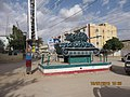 ASC Leiden - van de Bruinhorst Collection - Somaliland 2019 - 4404 - Public art. A camouflaged tank by Sarifle on a pedestal in a square. The Hargeisa War Memorial for the civil war with Somalia ending in 1991.jpg