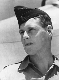 Outdoor head-and-shoulders portrait of man in tropical military uniform with forage cap