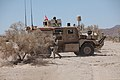 A Marine Corps Mine Resistant Ambush Protected vehicle waits near the side of a road during motorized vehicle operator training conducted by Combat Logistics Battalion 6, 2nd Marine Logistics Group, at Marine 130513-M-ZB219-012.jpg