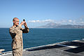 A U.S. Marine with the 26th Marine Expeditionary Unit (MEU) takes photos from the flight deck aboard the amphibious assault ship USS Kearsarge (LHD 3) while transiting the Strait of Gibraltar March 26, 2013 130326-N-GF386-374.jpg