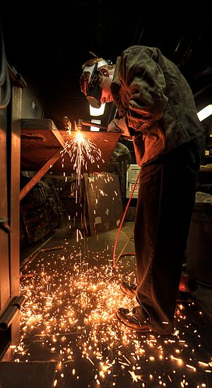 U.S. Navy Hull Maintenance Technician 3rd Class Robert Frey fabricates a steel countertop aboard the aircraft carrier USS Nimitz (CVN 68) Aug. 20, 2013, while underway in the Gulf of Oman.