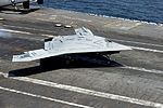 A U.S. Navy X-47B Unmanned Combat Air System makes an arrested landing aboard the aircraft carrier USS George H.W. Bush (CVN 77) as the ship conducts flight operations in the Atlantic Ocean off the coast of Vir 130710-N-LE576-002.jpg