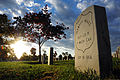 A headstone at Arlington National Cemetery in Arlington, Va., is seen at sunrise Nov. 2, 2013 131102-G-ZX620-061.jpg