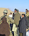 A member of coalition special operations forces speaks with an elder in Baron China village in the Shah Joy district of Zabul province, Afghanistan, Jan 120131-N-CI175-161.jpg
