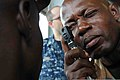 A member of the Cameroonian Rapid Intervention Battalion performs an eye exam with equipment provided by the U.S. Navy during a health care workshop as part of Africa Partnership Station (APS) 2013 in Douala 130327-A-VW915-032.jpg