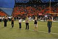 A spouse representing each branch of the U.S. Armed Forces stands on the field of the Aloha Stadium before receiving Hawaii's Outstanding Military Key Spouse Award, during an annual military appreciation night 131130-A-RV513-002.jpg