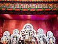 A traditional image of Maa Durga killing Mahishasura as she is surrounded by other major Hindi deities.jpg