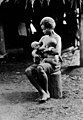 A woman suckling two babies. Wellcome M0013582.jpg