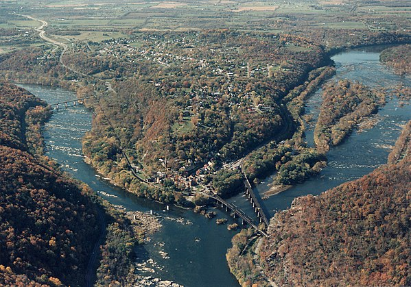 Looking upstream, the Shenandoah River (left) is a tributary of the larger Potomac River (right) Aerial Photo of Harpers Ferry (15646790473).jpg