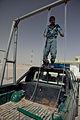 Afghan police build swing set for boys school 120517-M-DM345-012.jpg