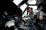 Airman 1st Class Ian Wilkerson checks the radio systems of an HH-60G Pave Hawk helicopter during a preflight inspection at Kadena Air Base (26684759446).jpg