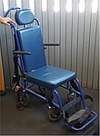 Aisle-chair for handling wheelchair-bound people in airplanes.jpg