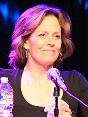 A smiling, casually-dressed Sigourney Weaver