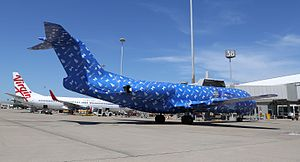 Powerball (Australia) - An Alliance Airlines Fokker 70 at Brisbane Airport, wrapped in Powerball wrapping paper (December 2016)