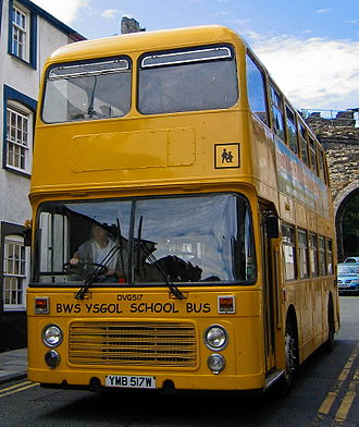 Student transport - A yellow painted UK Double Decker School Bus, usually these are operated for school routes only.