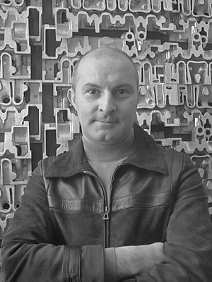 Arman - Arman in front of one of his Accumulations (1969)