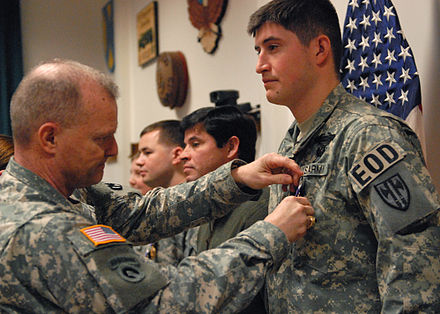 A soldier is awarded the Purple Heart during a ceremony on Coleman Barracks