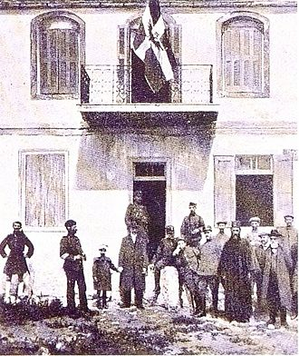 Autonomous Republic of Northern Epirus - The Northern Epirote flag as depicted by the French magazine L'Illustration (April 1914) in the Sarandë headquarters. Sarandë was one of the first cities that joined the autonomists' movement.