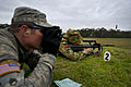 Australian army Pvt. Naomi Gangell, right, with the 10th Force Support Battalion, fires at a 300-meter target while U.S. Army Staff Sgt. Aaron Paul, with the 2nd Brigade, 25th Infantry Division, records her 120507-F-MQ656-070.jpg