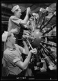 Aviation machinists mates at Navy Pier, Chicago, Illinois. Students working on a complex aircraft engine. - NARA - 520923.tif