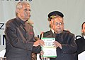 B.L. Joshi released the Souvenir of the 37th Indian Social Science Congress on 'Building An Ecologically Sustainable Society' and presented the first copy to the President, Shri Pranab Mukherjee.jpg