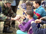 B020311d - 1LT Sean Mattingly shows how to tie square knot.png