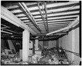 BASEMENT OF WEST ELL, LOOKING SOUTH - Harrington-Smith Block, 18-52 Hanover Street, Manchester, Hillsborough County, NH HABS NH,6-MANCH,6-9.tif