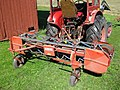 BM 230 Victor with Mads Amby side delivery belt rake.JPG