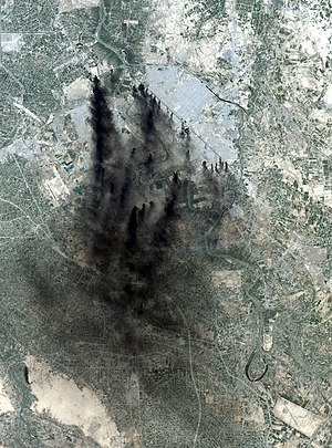 NASA Landsat 7 image of Baghdad, April 2, 2003. The dark streaks are smoke from oil well fires set in an attempt to hinder attacking air forces.