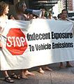 Banner protesting vehicle emissions at the World Naked Bike Ride, Auckland, New Zealand - 20050217.jpg