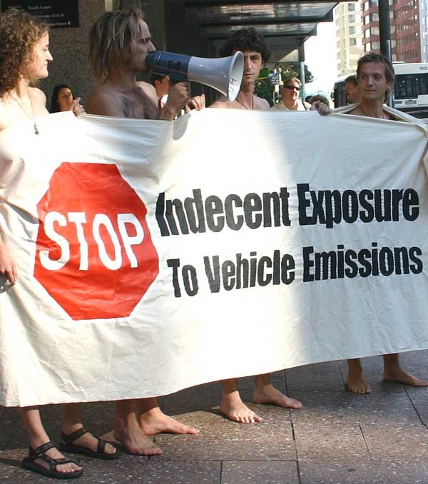 Banner protesting vehicle emissions at the World Naked Bike Ride, Auckland, New Zealand - 20050217