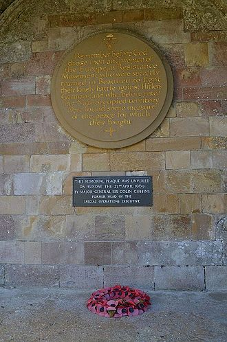 Special Operations Executive - SOE memorial plaque in the cloister of Beaulieu Abbey, Hampshire, unveiled by Major General Gubbins in April 1969.