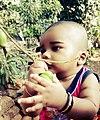 Beautiful baby with small mango.jpg