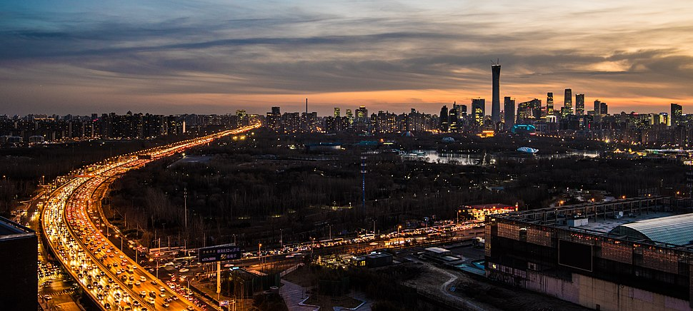 The skyline of eastern Beijing, including Beijing CBD, Chaoyang Park, and East 5th Ring Road at dusk