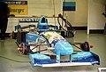 Benetton B195 - Johnny Herbert in the pit garage at the 1995 British GP, Silverstone (49713882687).jpg
